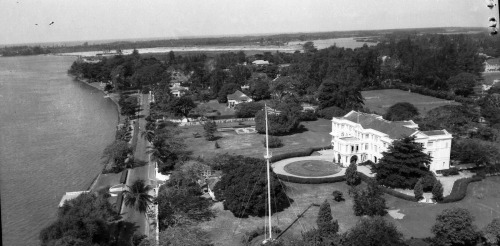 Baba GOVERNMENT (STATE) HOUSE MRINA LAGOS,WITH MARINA STREET AND THE LAGOON IN THE FOREGROUND.BUILT IN 1896,WAS THE OFFICIAL RESIDENCE OF THE COLONIAL GOVS.GENERAL